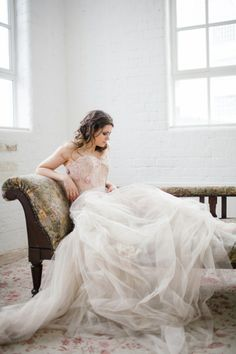 I love the way the lace is found throughout the tulle. An ethereal look.