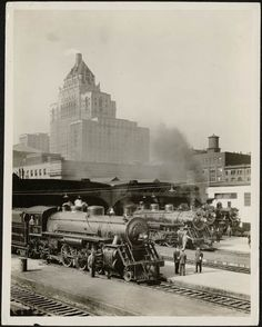 Steam engines, eastern entrance to Union Station, Toronto, with the Royal York Hotel in the background