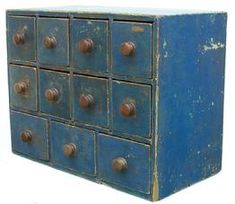 "New England 19th century eleven drawer Apothecary, in old blue paint,wonderful drawer lay out, all drawers are square head nail construction, the case is one board construction, all the original knobs, circa 1840 -1850  18"" wide x 13 3/4"" tall x 9"" deep"