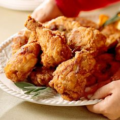 Timely Fried Chicken  Soak the chicken overnight in buttermilk, pat it dry before rolling in the seasoned flour (mix in some corn meal too) & the result is a more tender, moist & flavorful chicken when fried (peanut oil is best) or oven-fried.
