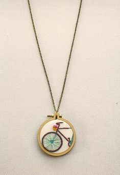 Hand embroidered bike necklace in a mini hoop handmade jewelry necklace mini embroidery hoop bike wedding jewelry The Bike Necklace>Embroidered Jewelry>Handstitched Jewelry>Mini Hoop Necklace>Bicycle Necklace>Bike Charm>Embroidery Designs>Ride On>Gift Embroidery Jewelry, Embroidery Hoop Art, Cross Stitch Embroidery, Embroidery Designs, Simple Embroidery, Jewelry Logo, Cute Jewelry, Jewelry Necklaces, Pandora Jewelry