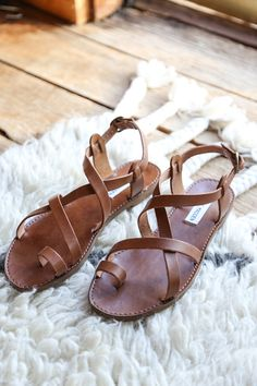 A simple cognac sandal from Steve Madden. - Leather - Strappy - Toe strap - Buckle closure - Imported