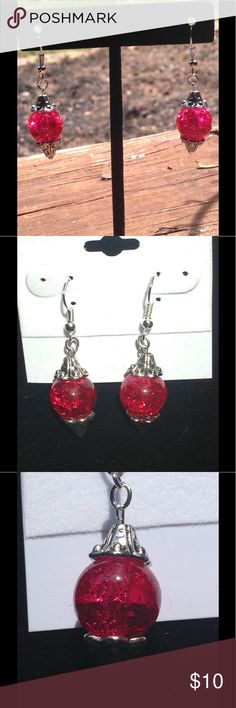 Red Sparkling Glass Dangle Earrings These pretty earrings are made with sparkling red glass beads. The hooks are silver plated. All PeaceFrog jewelry items are made by me! Take a look through my boutique for coordinating jewelry and more unique creations. PeaceFrog Jewelry Earrings