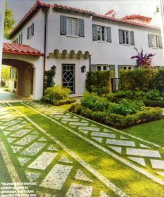 Coquina stone (native to FL) with Cashmere or Diamond (either can be used) zoysia grass is used to create this fully functional driveway. Perfect for south Florida.  Sanchez & Maddux Landscape Architects