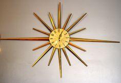 Vintage Mid Century Gold Starburst Clock by by LuckySevenVintage, $195.00 #vintage #luckysevenvintage #clock
