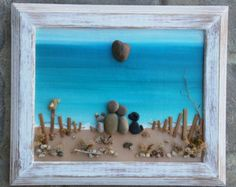 FREE SHIPPING  This will be made to order: Wonderful piece depicting a sweet pebble art couple sitting on a bench at night looking at the moon. Materials used are dried sage, pebbles/rocks, and flower buds/desert plants The original pictured is set in a reclaimed/vintage, open 5 x 7 wood frame, painted in acrylics. NOTE: At the time of order, if I do not have this shape of frame, a standard square 5x7 frame will be used.  Thank you so much for looking. Please message with any…