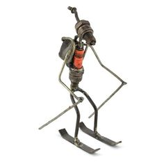 Artisans in Ougadougou, Burkina Faso, turn recycled spark plugs into whimsical sculptures. This one makes a perfect gift for ski enthusiasts. Due to handcrafting and the use of re-purposed metal, no t