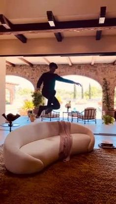 Flying ninja jumps into photoshoot, grabs a seat right in front of the camera on our EMBRACE SOFA! Wow! #nathananthony   EMBRACE SOFA. Designed by Tina Nicole. Ca Usa, Ninja, Sofas, Mid Century, Photoshoot, Furniture, Design, Couches, Photo Shoot