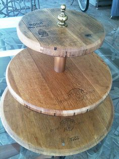 3 tiered cupcake stand made from the tops and bases of recycled Napa Valley wine barrels. Barrel Projects, Diy Wood Projects, Plateau Style, Wine Barrel Lazy Susan, Wooden Cake Stands, Wine Barrel Furniture, Barn Wood Crafts, Whisky, Kitchen And Bath Remodeling