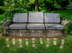 Stone sofa located in the Chanticleer Pleasure Garden in Wayne Pennsylvania