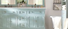 Want to refresh your bathroom? Try these bright teal cabinets!