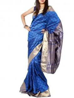 Royal Blue Benarasi Silk Upadda Sari from Sayisha. A touch of elegance and grandeur is the highlight of the sari with its royal blue shade and gold zari border. The zig zag border in the pallu and all over paisley design gives it a traditional look. Team with gold pair of earrings and an embellished clutch.  Available on www.designerkapde.com