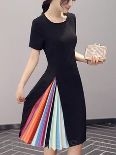 I've been looking for ways to update my wardrobe so I was delighted to come upon this dress! Sold in black or pink, the dress is simple until you get towards the bottom. That's where you'll find accordion style pleats in different colors of the rainbow. It's minimalism and rainbows in one! Called the Ericdress …
