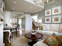Create a Grouping in The Art of Displaying Art from HGTV I also like the curtains hung to create a room divider