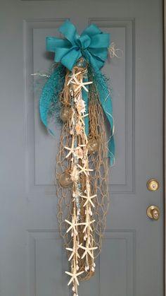 DIY Coastal Christmas Door Swag: starfish, net, ribbon. Love this! Many more coastal Christmas ideas!
