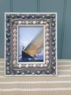 Shelled photo frame in blues, lavenders and green sea urchins and tusk shells Size - X X Shell Frame, Stuffed Shells, Shell Art, Interior Accessories, Sea Shells, Shell Mirrors, Shelled, Frames, Design