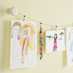 """Art Gallery:  """"One way that I love (to bring in color), which kids love too, is bringing in their own art,"""" designer Mary Wadsworth says. One way to create a low-cost gallery: Wire hanging systems (like this one from www.potterybarnkids.com) are easy to install and use, and kids can be in charge of what's on display."""