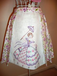 A gorgeous vintage apron with a southern belle... embroidery in lilac thread...