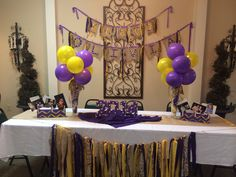 Olivia's LSU table and decor for her graduation party! Purple and Gold burlap pennant flags, balloon centerpiece.                                                                                                                                                     More
