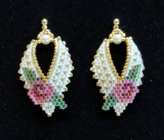 Flattering to any face shape and any neckline, these are Russian Leaf style earrings. Fashioned with Miyuki Delica beads (the finest Japanese seed beads available). Done in a roses motif, these are an original design created by me. Tightly woven, these earrings will retain their shape and sparkle for years to come. The approximate length for these earrings is 1 and 1/2 inches long, on gold plated posts. They are lightweight and very comfortable to wear. Your new earrings will arrive gift…