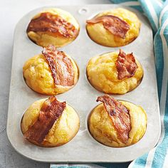 Bacon-and-Egg Muffins - Corn bread meets bacon and egg sandwich in these quick and easy breakfast muffins that feature crispy bacon and melty cheddar.  Serve them warm and drizzled with sweet maple syrup :)