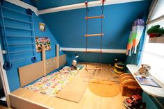Playroom that turns into a bedroom. Bed is under the floor panels. I love IKEA!