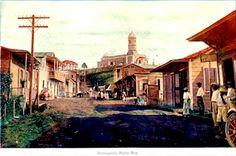 Pueblo de Hormigueros,Principio del siglo XX, al fondo sobre la loma el santuario de Nuestra señora de Monserratet,Puerto Rico.