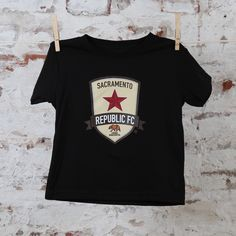 3344acd5f Outfit your littlest Republic FC fan in the original black tee. This black  toddler-sized t-shirt features the Sacramento Republic FC colored crest.