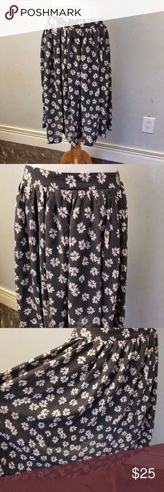 Nwt floral skirt brand new with tags black skirt with daisy flowers. lines 100% polyester Skirts Midi