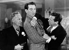 "Otto Kruger, Mike Mazurki, and Dick Powell in the 1944 classic film noir ""Murder, My Sweet."""