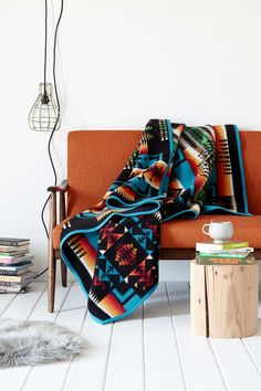 Love that drape, love the colours of it and the colours with the chair behind it too.