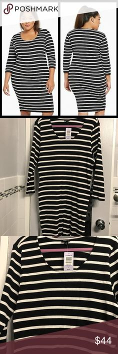 "Torrid Ribbed Bodycon Stripe Sweater Dress Size 4X This is a brand new with tags black and white striped bodycon ribbed sweater dress from Torrid in a size 4 which correlates to a size 26/28.  This dress is approximately 44"" long.  Keep in mind even though it's a sweater dress it's a bodycon style which means it's supposed to be tight against your body.  #116 torrid Dresses Midi"