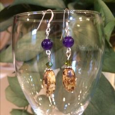 Amythyst natural stone earrings AAA  Amythyst beads and a beautiful natural picture jasper and a green Swarovski crystal  with 925 ear wire they hang about 1 1/2 inches. NWOT. Can give you a great bundle price. Jewelry Earrings