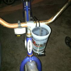 Homemade drink holder. Read: amplifier for your iPhone. My bike didn't have a drink holder and I wanted a way to listen to/hold my iPhone while I rode my bike. This worked perfectly! We took a plastic cup, drilled 2 holes into it and zip tied it to my bike. Hobo accessory? I think not!