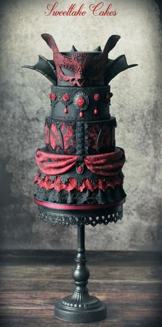Vampire masquerade cake, cant decide between this or the other for the main cake!