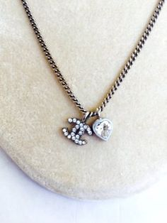 Chanel Diamond CC Heart Necklace . Get the lowest price on Chanel Diamond CC Heart Necklace  and other fabulous designer clothing and accessories! Shop Tradesy now