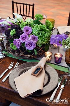 Purple Wedding Inspiration: Twisted branches and green blooms create the perfect canvas for light purple roses. http://www.colincowieweddings.com/flowers-and-decor/purple-wedding-flowers
