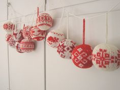 Julekuler, 2010 by yarn jungle, via Flickr  Red and white knitted Christmas ornaments, Nordic style from book 55 Christmas Balls to Knit by Arne Nerjord http://www.amazon.com/Christmas-Balls-Knit-Decorations-Centerpieces/dp/1570764875