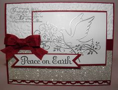 Peace on Earth silver embossed dove Christmas card with ribbon. By Gretchen Barron