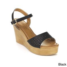 Revel in resort-ready style in these platform sandals. This wedge covered faux leather upper, ankle strap with adjustable buckle accent, wedge platform and heel, single band front with cut out detail. Finished with lightly padded insole for comfort.