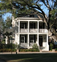 charleston, sc ..2 story rocking chair porch..  white and black house