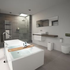 Clou - 'Match Me' concept bathroom. This bathroom has a Wash Me freestanding bath. The shower is foreseen with a rainshower. The bathroom is finished with grey tiles. The washbasin is placed on a ottawa pine shelf and foreseen with mixertap.