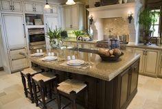Mediterranean Kitchen with limestone tile floors, MS International Amber Yellow Granite Countertop, Farmhouse sink, Flush