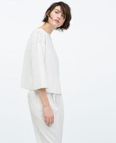 Imagem 2 de TOP GOLA DE BEBÉ CROP da Zara