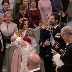 Princess Sofia of Sweden beamed with pride as she held her youngest son Prince Gabriel inside the chapel while her husband Prince Carl Philip of Sweden had their eldest son Prince Alexander during traditional christening of their youngest son Prince Gabriel at the Drottingholm Palace Chapel on December 1, 2017 in Sweden