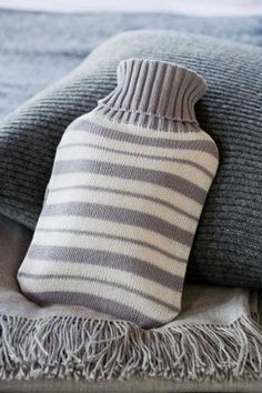 great idea for the hot water bottle compress!  enclose it in an up-cycled sweater sleeve cut and sewn to fit!
