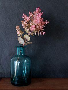 Bringing nature in w/ eucalyptus kruseana branch in simple colored vase