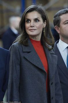 Queen Letizia of Spain, 45, looked trendy as she stepped out a matching coat and skirt in block colours as she visited the headquarters of Spanish brand Joma Sports in Toledo.