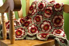 Floral Crochet Afghan (Kiwi Afghan) pattern: http://www.ravelry.com/patterns/library/kiwi-afghan