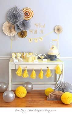 This gender reveal baby shower bee theme party in yellow & gray will get everyone buzzing from Cricut & The Celebration Shoppe.
